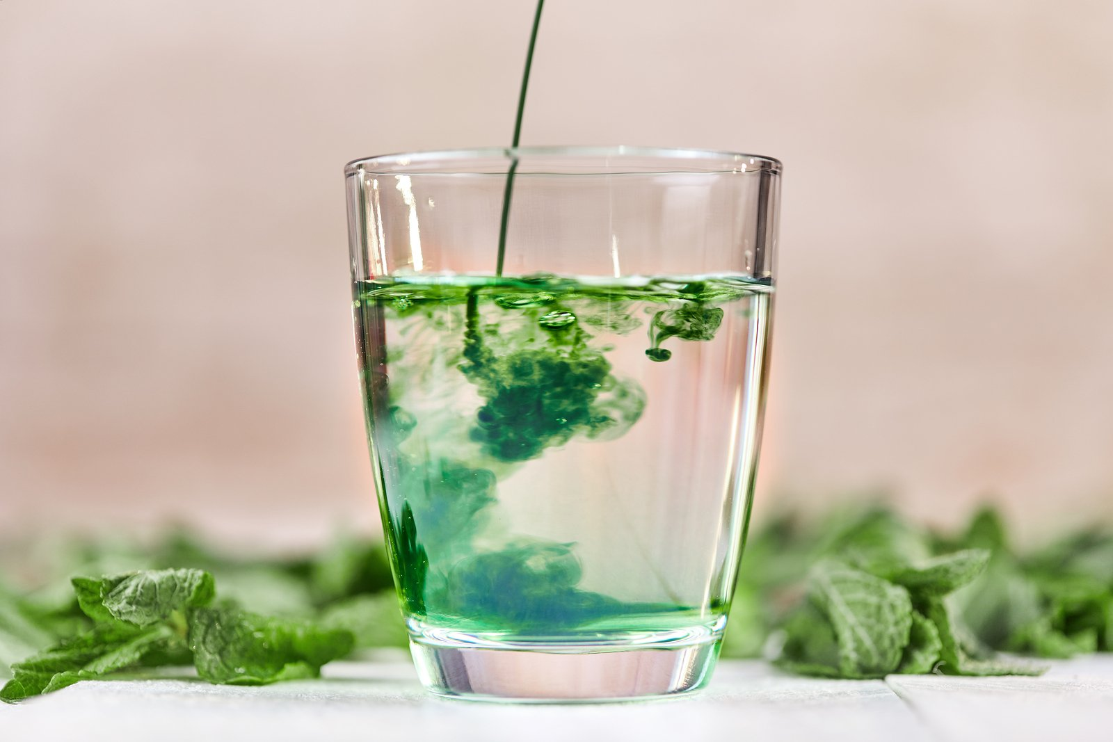 Dissolving Liquid Chlorophyll In Glass Of Water